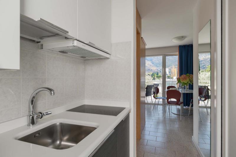 Spacious holiday apartments front lake in Torbole | Residence Toblini Casa al Lago
